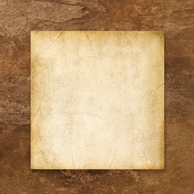 Old blank paper on brown weathered wooden background