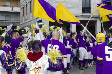 S.Egidio, Italy - March 2, 2014: Happy masked people celebrating the Italian Carnival 2014
