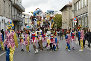 S.Egidio, Italy - March 2, 2014: Floats and happy masked people walking the streets of Sant'Egidi