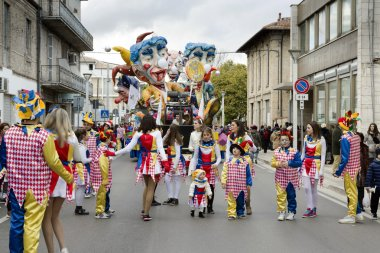 S.Egidio, Italy - March 2, 2014: Floats and masked people walking the streets of Sant'Egidio alla