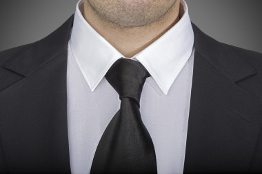 Closeup view of jacket and tie