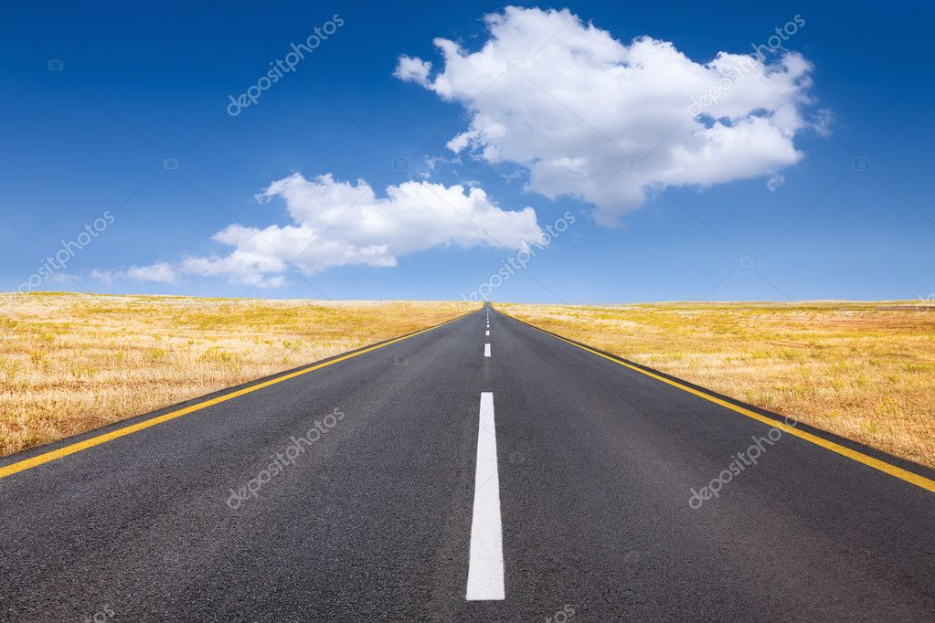 Driving on an empty road at bright sunny day