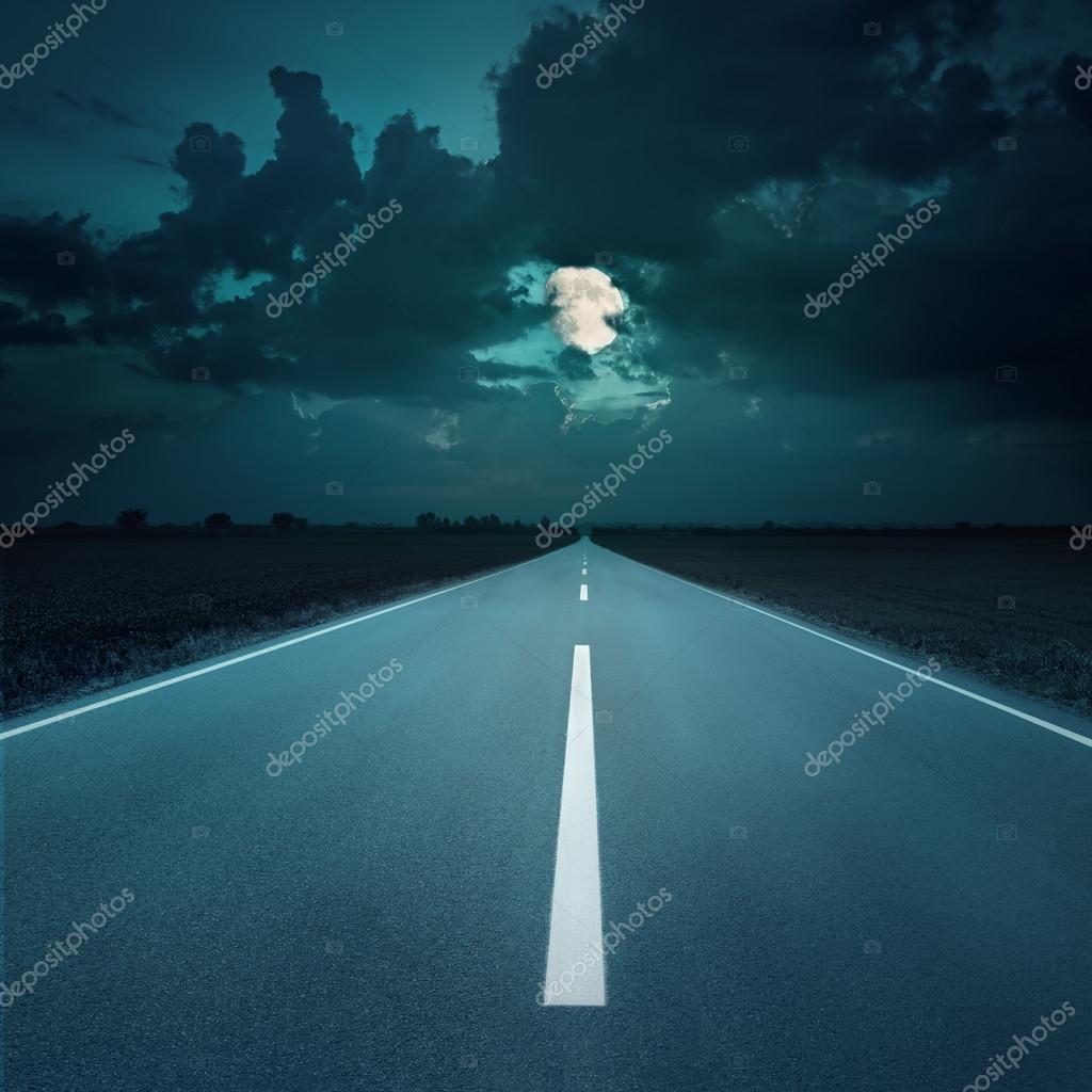 Night driving on an empty road to the moon