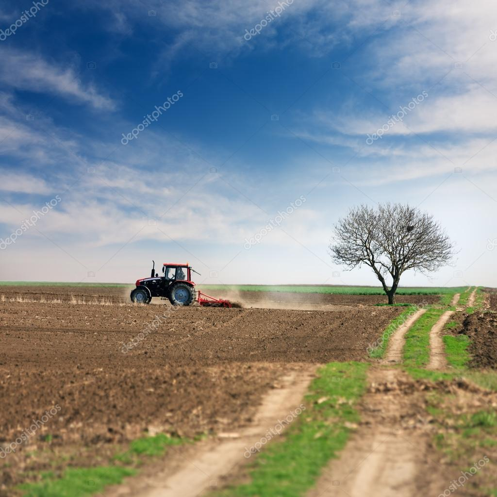 Processing of land with tractor