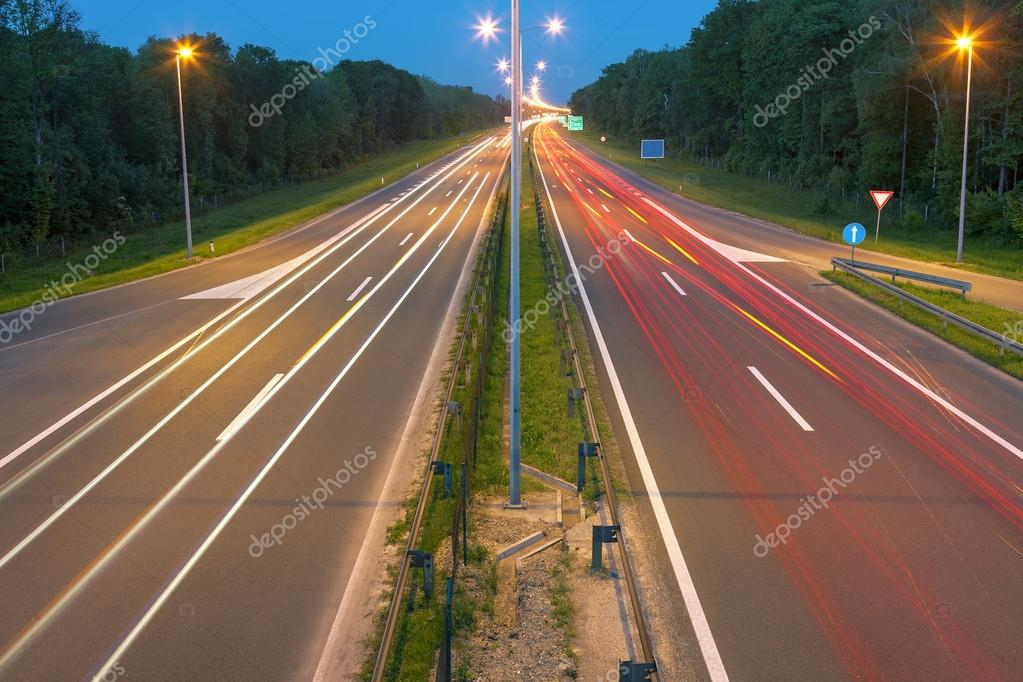 Highway with light trails at dusk