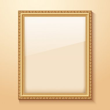 Empty gold frame hanging on the wall.