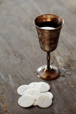 Chalice with wine and communion wafers