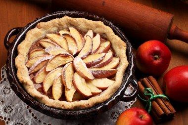Apple pie in baking tin