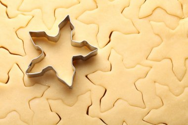 Pastry for Christmas cookies and snowflake cookie cutter