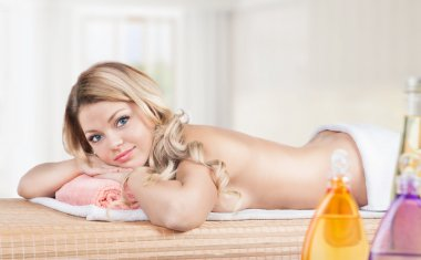 Massage.Spa Salon. Beautiful young woman lying on the massage table. Relax procedure.