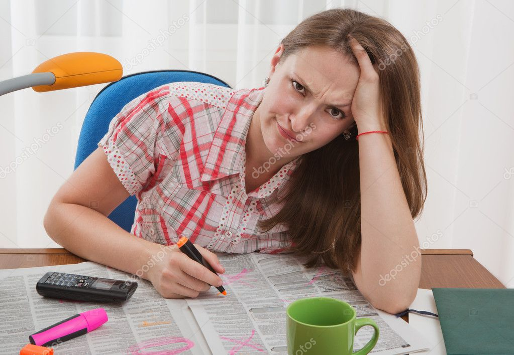 Searching for job. Young woman is search job. She is in despair.