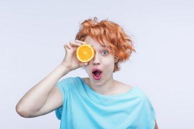 Emotional surprised beautiful woman with orange