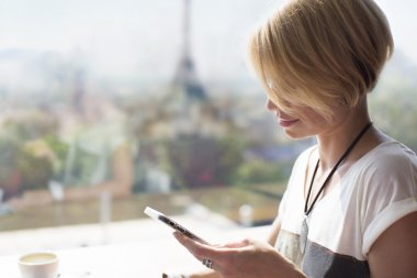 Woman smartphone Paris cafe