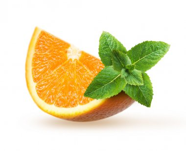 Orange fruit slice with green mint leaves isolated.