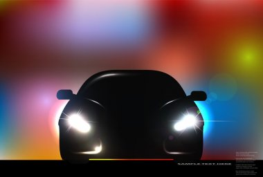 Silhouette of car with headlight