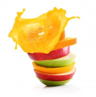 Stack of orange fruit and apples slices