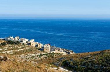 Bay view in Malta island with boats and clear blue sea and sky background, touristic destination in Malta, Blue Grotto, popular place in Malta, maltese landscape, Malta, Europe