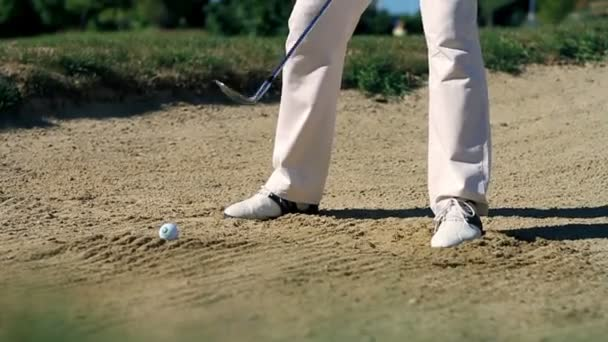 Shot of a man golfer on a sand golf course practising hits