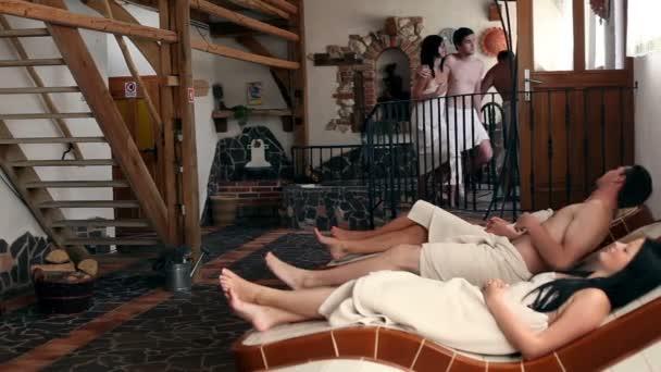 People relaxing in sauna