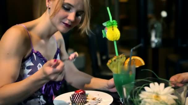 Woman eating sweets and drinking coctail