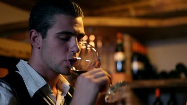 Young man tasting wine in wine cellar