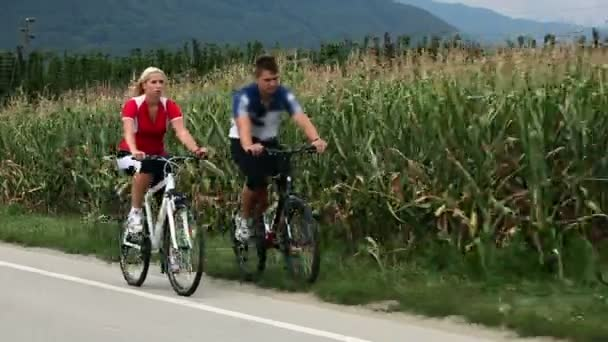 Total of young couple cycling in countryside