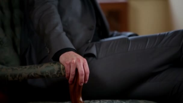 Close up of a business man sitting on an old fashioned sofa