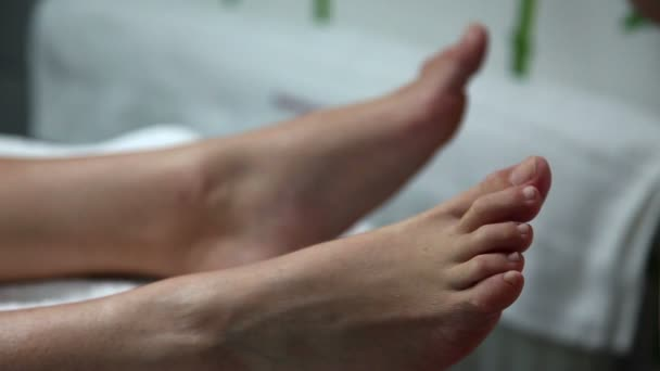 Woman getting feet fixed in a beauty salon