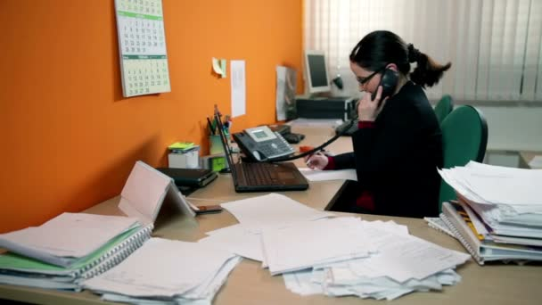 Business woman having a lot of work in office