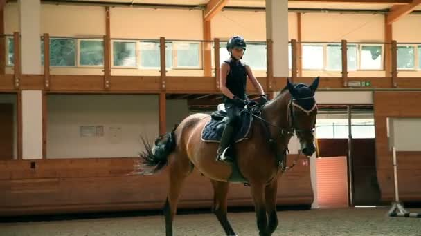 Big hall for training young girl riding horse for equestrianism