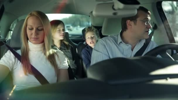 Kids in the back of the car having fun while parents driving car