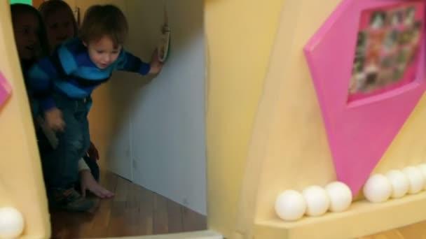 Kids in kindergarten crawling on floor
