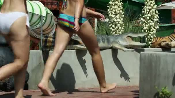 Tilting over pool attractions while people going to next amusement