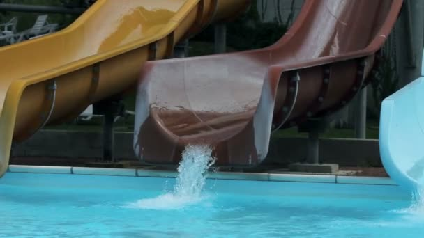 Close up on waterslide while couple sliding down