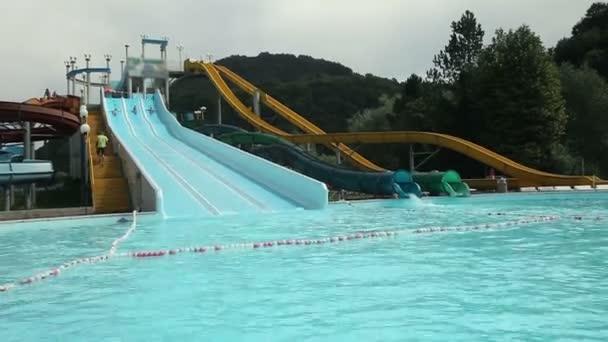 Sliding down the racing pool waterslide