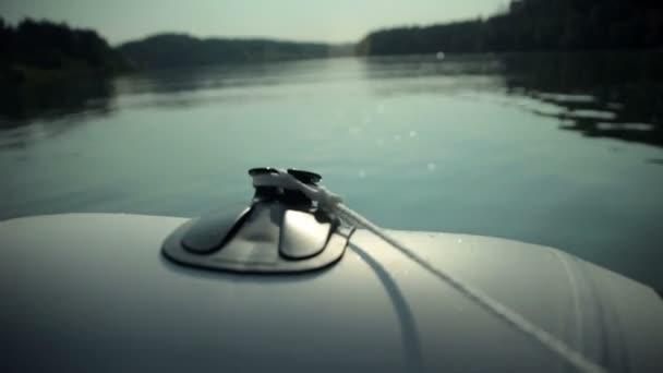 Close up on motor boat speeding on lake