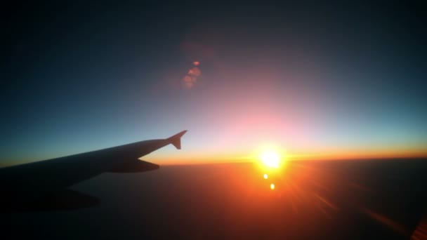 Watching beautiful sunrise while flying with airplane