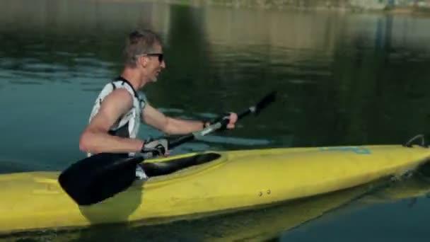Close up on kayaker enjoyin kayaking in lake