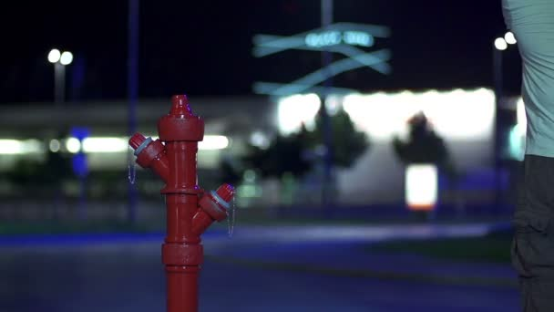 Man destroying the hydrant prop with a golf stick in slow motion