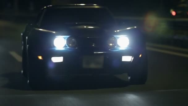Frontal Shot Of Corvette With Headlights Turned On