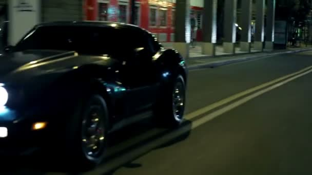Corvette Gracefuly Driving Through The City At Night