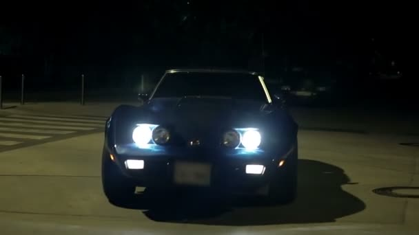 Front View Of Corvette Driving Towards The Camera At Night
