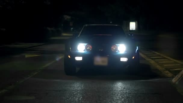 Corvette is slowly approaching the camera with the headlights light up