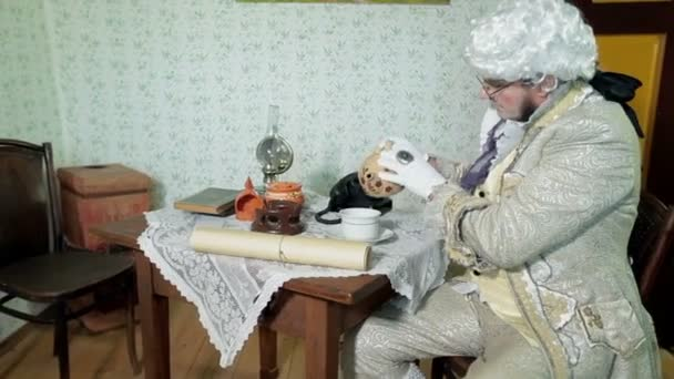 Man from enlightenment era is pouring himself a cup of tea