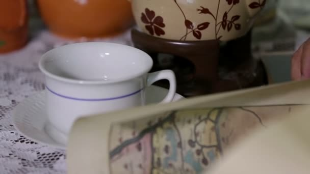 Shot of tea cups and a jar on the table