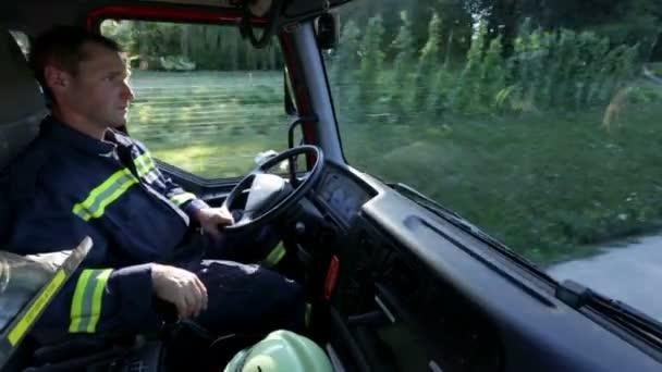 Fireman in a cabin driving a truck
