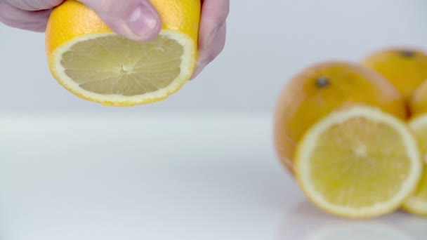 Squeezing lemon with palms