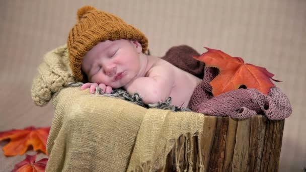 Baby with brown cap sleeping peacefully