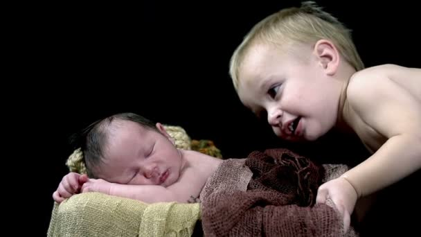 older brother observed baby boy from above