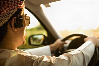Arabian Businessman Driving Car